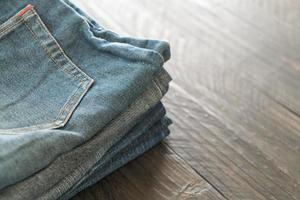 Stack of jeans on wood floor