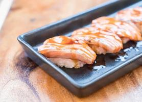 Salmon burned sushi with teriyaki sauce