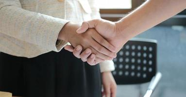 Manager and employee shaking hands