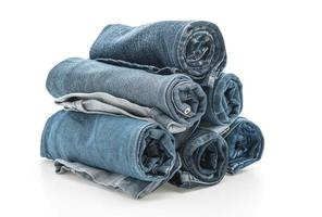 Stacks of rolled jeans