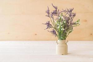 Statice and caspia flowers on wooden background