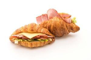 Ham croissant sandwich on white background photo