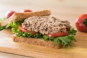 Tuna sandwich on wood board