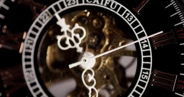 Extreme close up of pocket watch with exposed machinery coming in 4K video