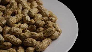 Cinematic, rotating shot of peanuts on a white surface - PEANUTS 022