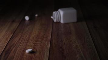 Slow motion of Medical pills bottle falling on floor