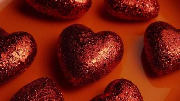 Rotating stock footage shot of Valentines decorations and candies - VALENTINES 0033