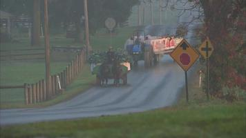 Amish farmers ride down road