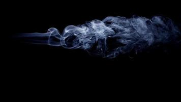 Dark background with smoke with horizontal path and beautiful swirls in 4K