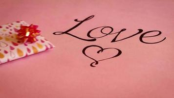 Love Lettering With Gifts On Warm Pink Background