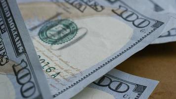 Rotating stock footage shot of $100 bills - MONEY 0136