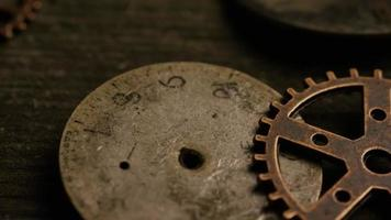 Rotating stock footage shot of antique and weathered watch faces - WATCH FACES 067