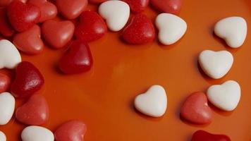 Rotating stock footage shot of Valentines decorations and candies - VALENTINES 0053 video