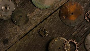 Rotating stock footage shot of antique and weathered watch faces - WATCH FACES 078