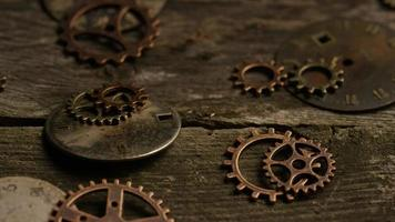 Rotating stock footage shot of antique and weathered watch faces - WATCH FACES 065