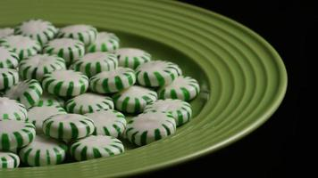 Rotating shot of spearmint hard candies - CANDY SPEARMINT 053 video