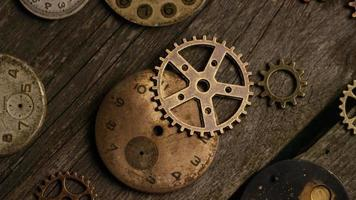 Rotating stock footage shot of antique and weathered watch faces - WATCH FACES 080