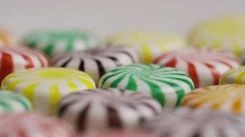 Rotating shot of a colorful mix of various hard candies - CANDY MIXED 033 video