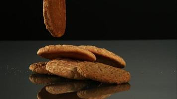Cookies falling and bouncing in ultra slow motion (1,500 fps) on a reflective surface - COOKIES PHANTOM 116 video