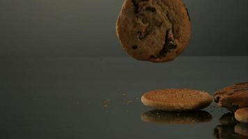 Cookies falling and bouncing in ultra slow motion (1,500 fps) on a reflective surface - COOKIES PHANTOM 122 video