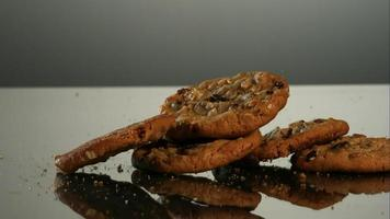 Cookies falling and bouncing in ultra slow motion (1,500 fps) on a reflective surface - COOKIES PHANTOM 075 video