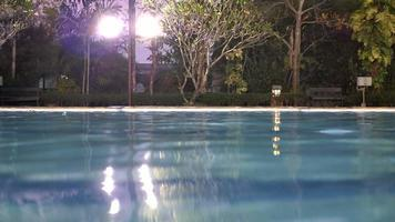 Night view of outdoor swimming pool.