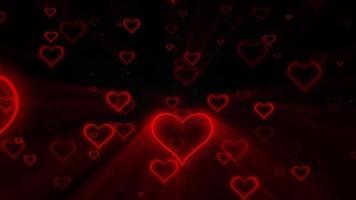 San Valentín corazones rojos con lazo de fondo de rayos de luz