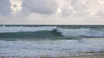 Ocean with waves splashing on the beach. Phuket, Thailand.