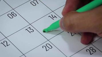Calendario del mes de febrero con símbolos de hombre y mujer.