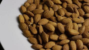 Cinematic, rotating shot of almonds on a white surface - ALMONDS 024