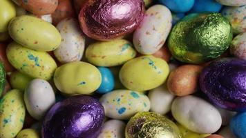 Rotating shot of colorful Easter candies on a bed of easter grass - EASTER 164 video