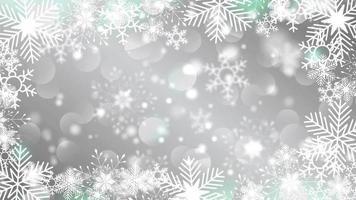 schöne Schneeflocken, die auf einem grauen Hintergrundlinsenfackelbokeh rotieren