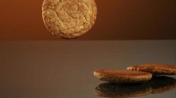 Cookies falling and bouncing in ultra slow motion (1,500 fps) on a reflective surface - COOKIES PHANTOM 099 video