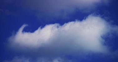 Time lapse of bright cirrus and altocumulus clouds moving on blue sky in 4K
