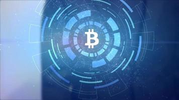 hombre de negocios mano holograma hud proyección bitcoin icono de criptomoneda video