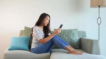 Woman Using Mobile Phone  video