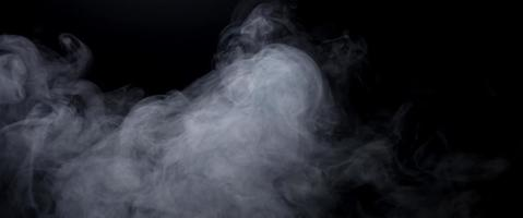 White controlled smoke drawing beautiful swirls on dark background in 4K