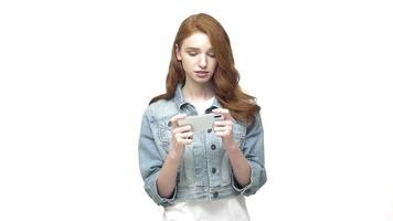 Young happy woman playing a game on a smartphone
