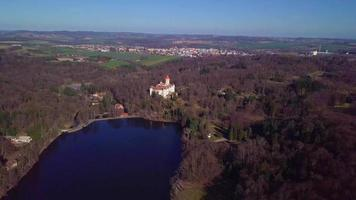 Downward View Over a River Towards a Castle in 4K