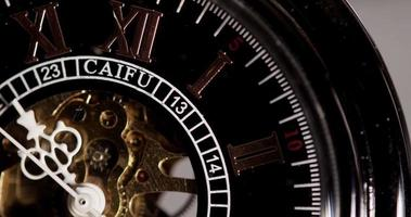 Extreme close up of pocket watch with exposed machinery coming for thirty seconds in 4K video