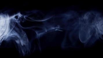 Beautiful smoke clouds exposed by a light ray on dark background in 4K