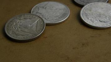 Imágenes de archivo giratorias tomadas de monedas americanas antiguas - dinero 0052