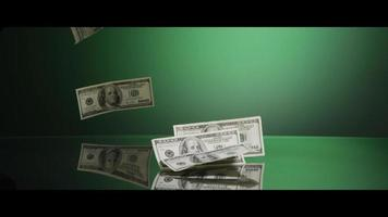 American $100 Bills Falling onto a Reflective Surface - MONEY 0006