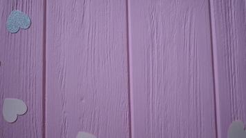 Geschenkbox auf rosa Holzboden video