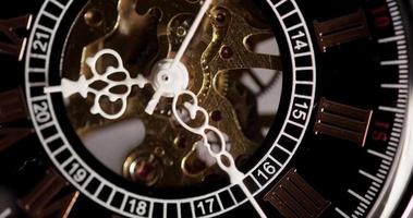Extreme close up of pocket watch with exposed machinery coming from 9:20 to 9:33 in 4K time lapse video