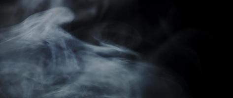 White smoke floating and drawing swirls and desappearing on dark background in 4K