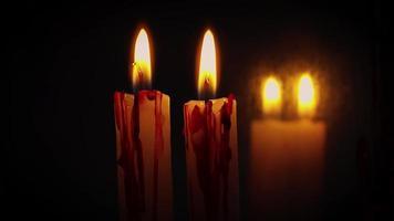 velas sangrentas e espelho