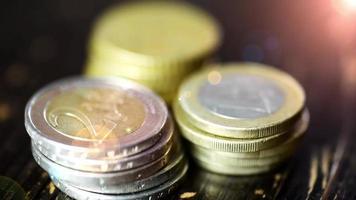 Euro coin on wooden table- financial power concept, closeup dolly shot