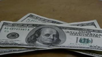 Rotating stock footage shot of $100 bills - MONEY 0155