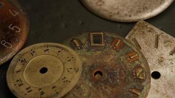 Rotating stock footage shot of antique and weathered watch faces - WATCH FACES 002